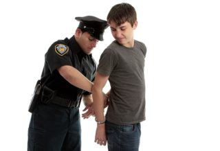 Teen in cuffs